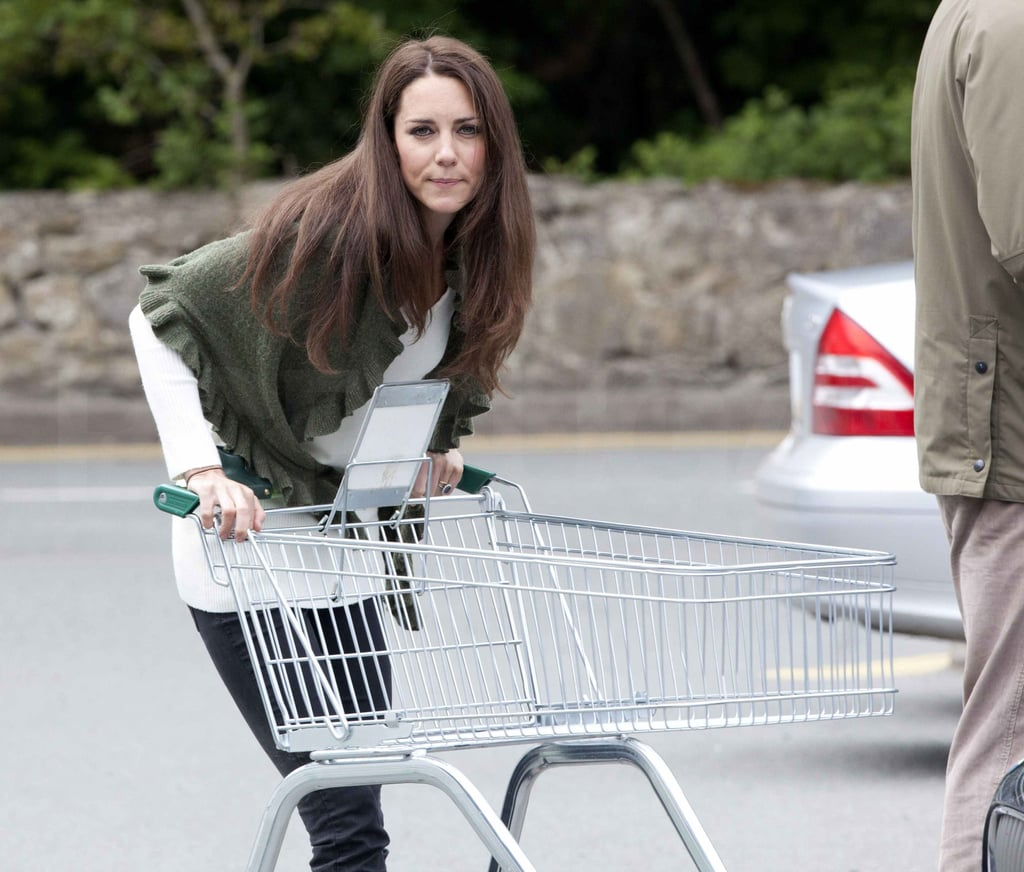 Kate Middleton dressed casually in a white top and green poncho yesterday to run to a Waitrose grocery store in Anglesey, Wales, where she and her new husband, Prince William, call home during his stints working with the Royal Air Force. She had a protection officer by her side as she walked the aisles, but Kate was happy to push her own cart while browsing. It was a big return to normalcy for Kate, despite her very atypical nuptials last week! Over two billion people watched the royal wedding, and mania for all things Kate and William continues. There is a great deal of excitement about their upcoming official tour of Canada, which will wrap up with a diversion to California from July 8 to the 10 — it will actually be Kate's first-ever visit to the United States! Meanwhile, dress makers are frantically trying to rush copies of her Sarah Burton for Alexander McQueen wedding dress into shops across the world. Even the white dress worn by her sister, Pippa, is a hot commodity when it comes to selling their style to brides and maids of honor worldwide. Kate and William unfortunately had to postpone their honeymoon for unknown reasons, instead spending the few days after the ceremony at an undisclosed location within the UK.  Source: Alan Carsen/Whitehotpix/ZUMAPRESS.com