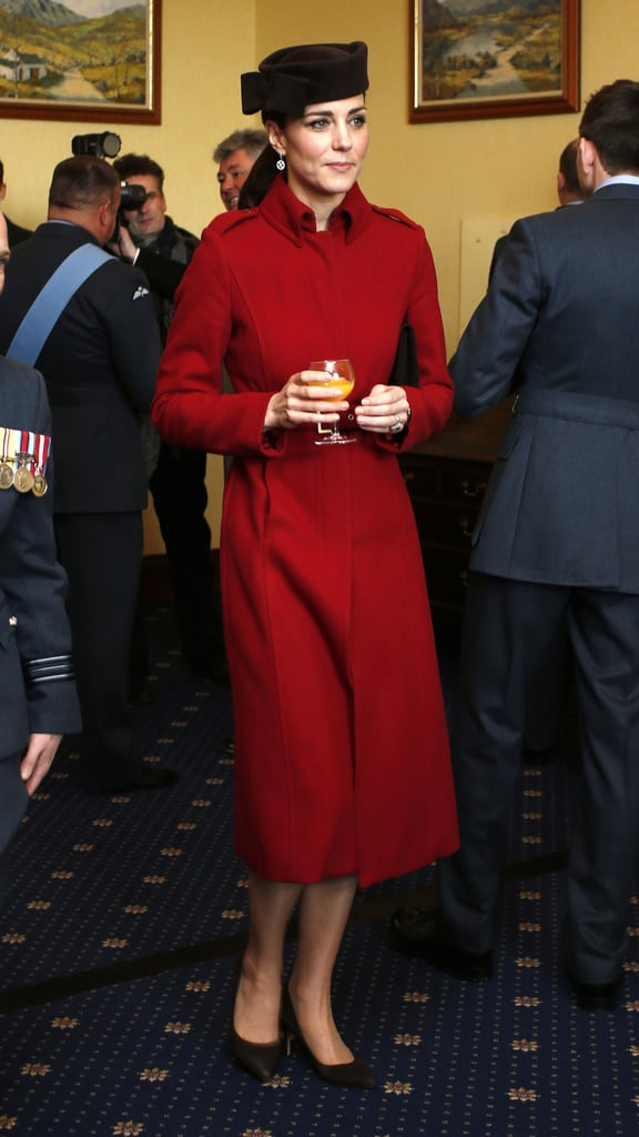 Kate accessorised her L.K. Bennett coat with chocolate brown accents.