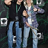 Skylar Astin and Anna Camp as Wayne and Garth From Wayne's World