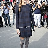 Leave it to Olivia Palermo to rock a Zara dress to Paris Fashion Week. She upped the glam factor thanks to a pair of gray suede over-the-knee boots, a green clutch, and statement sunglasses while outside the Carven show.