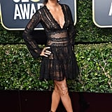 Halle Berry wearing a Zuhair Murad dress with Jimmy Choo shoes and jewels by Maxior, AS29, and Swarovski in 2018.