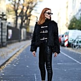 Wear leather skinnies with a voluminous shaggy jacket and tall white pumps.