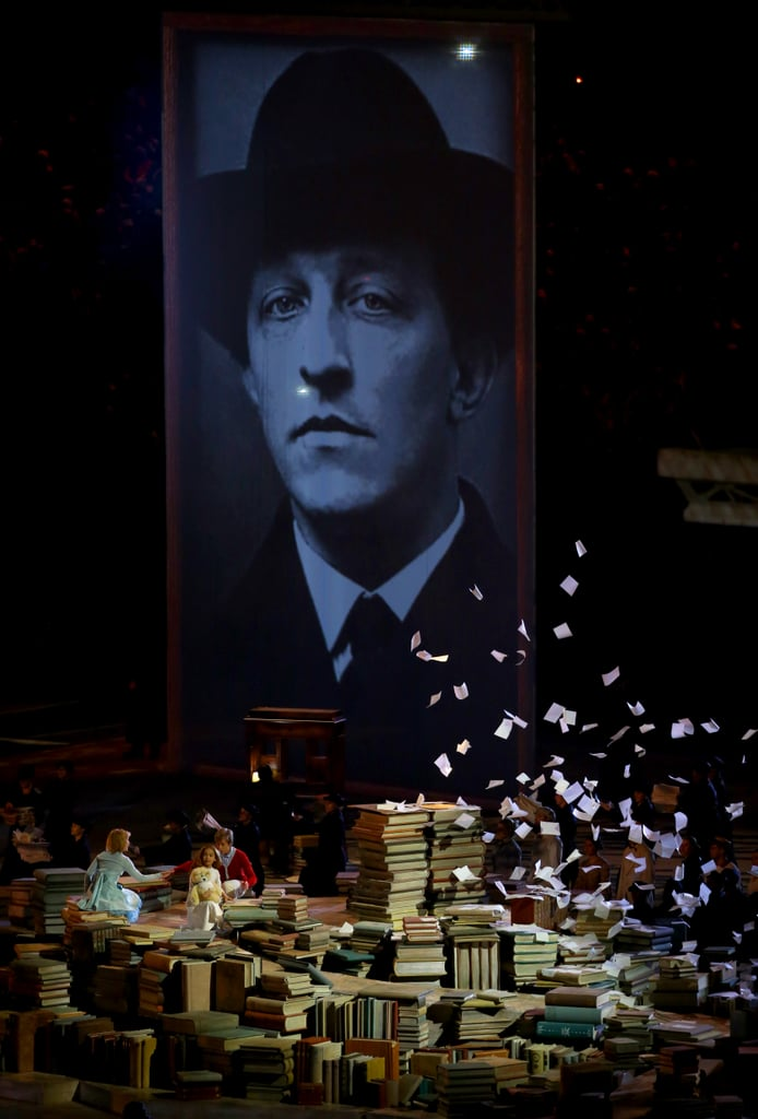 Stacks of books sat beneath each portrait, with book pages fluttering in the air like confetti.