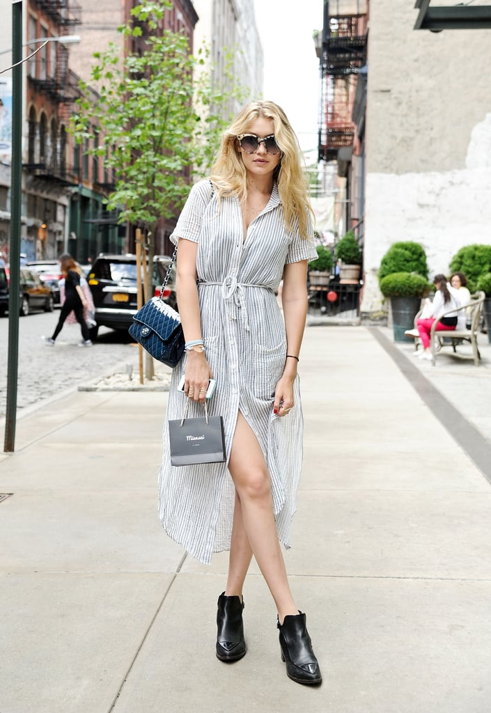 On the streets of the NY neighborhood of SoHo, Gigi slipped into a breezy Reformation dress and Chanel booties.
