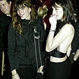 The ever-stylish sisters stuck close while at a Paris gala in 2004.