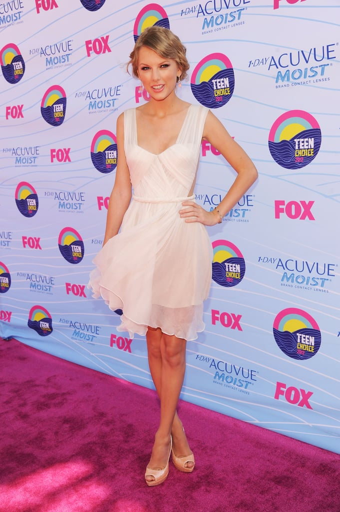"Taylor Swift struck a sweet pose on the carpet at this evening's Teen Choice Awards in LA. Taylor wore a Maria Lucia Hohan LWD with a pair of Christian Louboutins. She attended to see if she's taking home any big honors this evening. Taylor's in the running in multiple categories, including choice female country artist, choice female artist, choice country song for ""Sparks Fly,"" and choice single by a female artist for ""Eyes Open."" She's also recognized for her film work. Taylor's up for choice movie voice thanks to her role as Audrey in Dr. Seuss' The Lorax."