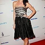 Juliette Lewis wore a strapless knee length dress.