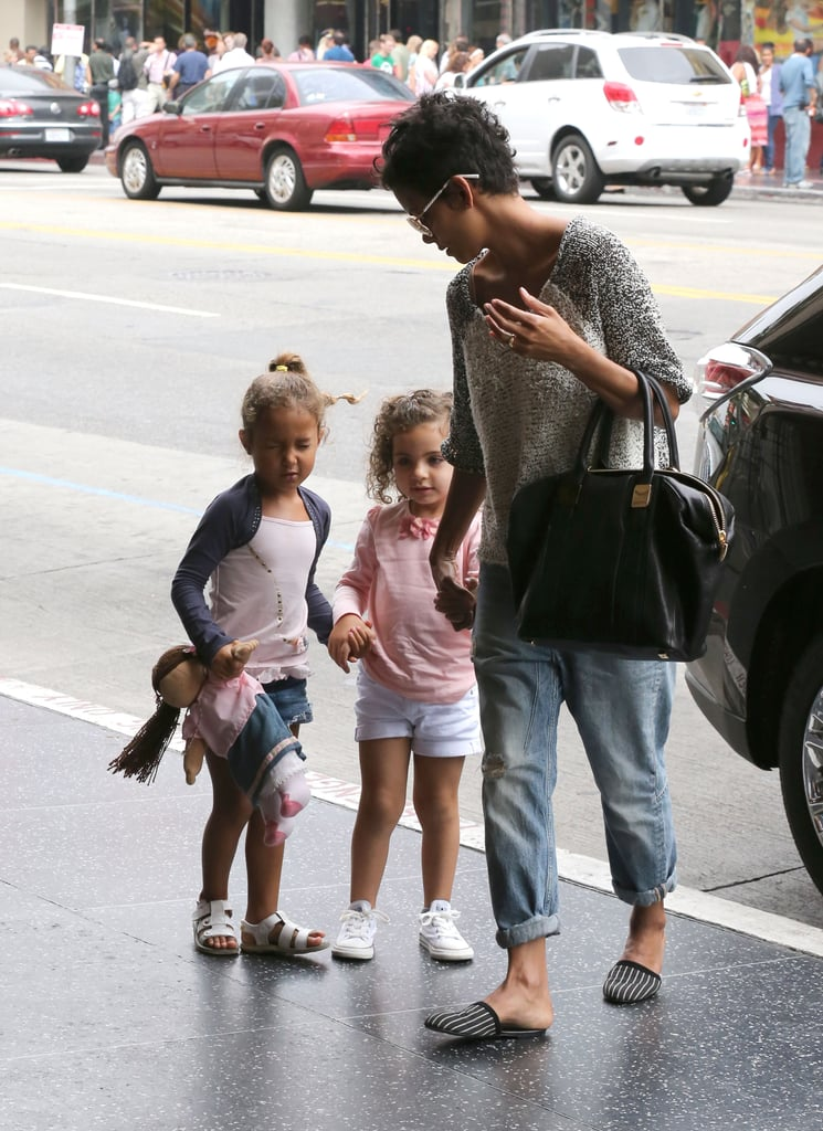 Halle Berry spent her Saturday afternoon taking her 4-year-old daughter, Nahla Aubry, and a friend to the movies in LA. Halle was casual in cuffed jeans and striped flats for the outing. Halle's enjoyed some time off this Summer, but she'll return to the big screen this October when she stars in Cloud Atlas alongside Tom Hanks, Hugh Grant, and Susan Sarandon.  Earlier this month, Halle and her fiancé, Olivier Martinez, celebrated her 46th birthday on a double date with Salma Hayek and François-Henri Pinault. Halle has been spending much of her time on the West Coast lately, but has expressed a desire to move with Nahla to Olivier's native France. She's currently asking the court to amend her custody agreement with Nahla's father, Gabriel Aubry, to allow her to live overseas with her daughter.