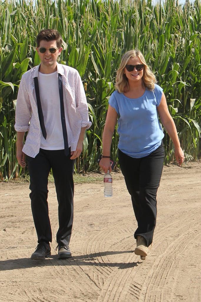 Adam Scott is looking casual as Ben, alongside Amy Poehler as Leslie.