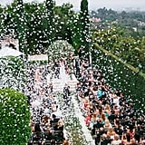 As you share your first kiss as a married couple, shower your guests with thousands of flower petals blown out of cannons!