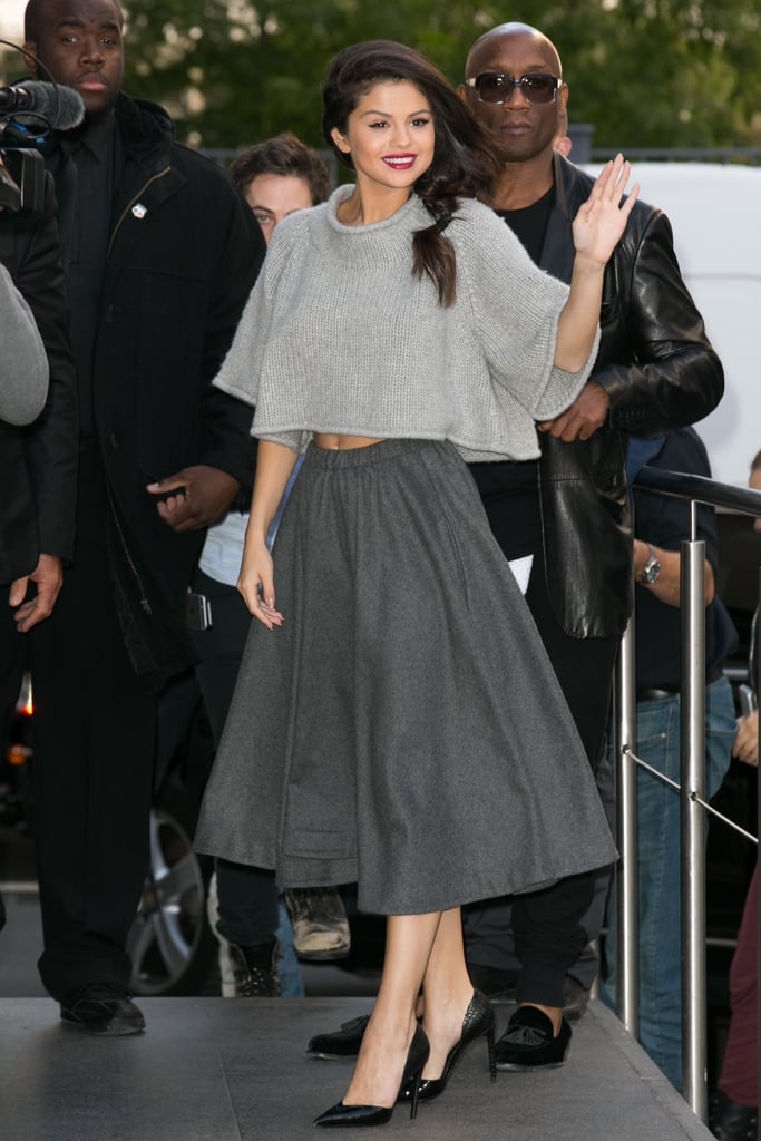 Fall staple: A gray oversize knit from Co. Selena wore it with: A matching flared midi skirt from Co and Louis Vuitton pumps in Paris in September 2015.
