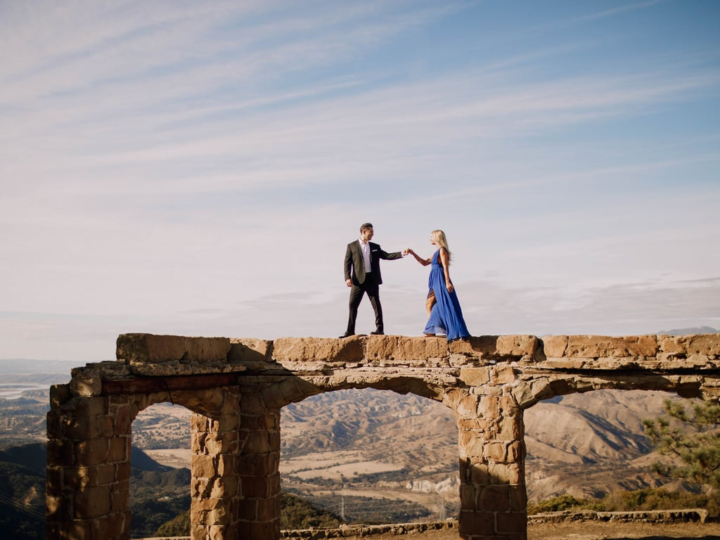 "There are some photos that grab your attention and completely mesmerize you. That's how you'll feel about every single image from Jesse and Sean's stunning engagement shoot. The pair climbed the ruins of a castle to pose for photos that look like they came out of a high fashion magazine. Your jaw will drop at the heights the couple reached in order to get the perfect final result. They then changed locations, grabbed some sparkling wine, and captured their love on film against the backdrop of a foggy West Coast beach.  ""Jesse and Sean are such a fun-loving couple, with classic charm,"" said photographer Danielle Determan. ""We knew a traditional setting with an adventurous quality would be the perfect fit for their Winter engagement session, so we set out for Knapp's Castle. The ruins sit amongst the gorgeous Santa Barbara Mountains. Jesse wowed in a royal blue LuLu's gown, holding the dreamiest bouquet of florals created by Wildflowers Floral Design. We wrapped our session on the sand with champagne and stroll in a foggy haze making for the most romantic setting possible.""  See the awesome photos ahead!      Related:                                                                                                           Everyone Can Stop Trying to Have an Epic Wedding — This Couple Nailed It in Iceland"