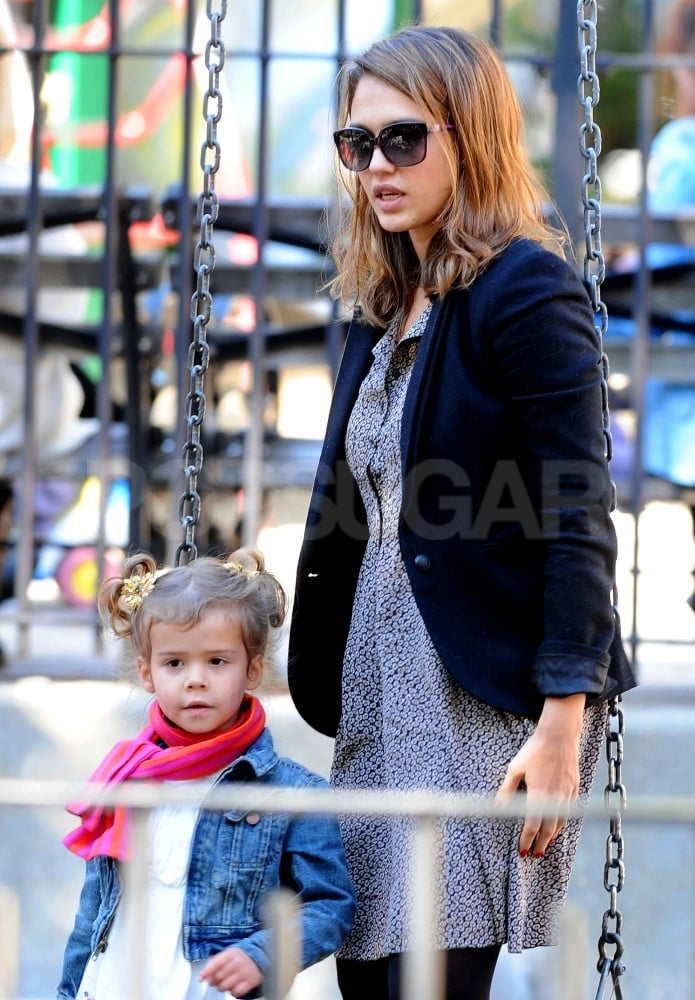 Jessica Alba and Honor Warren considered the swing set in a NYC park.