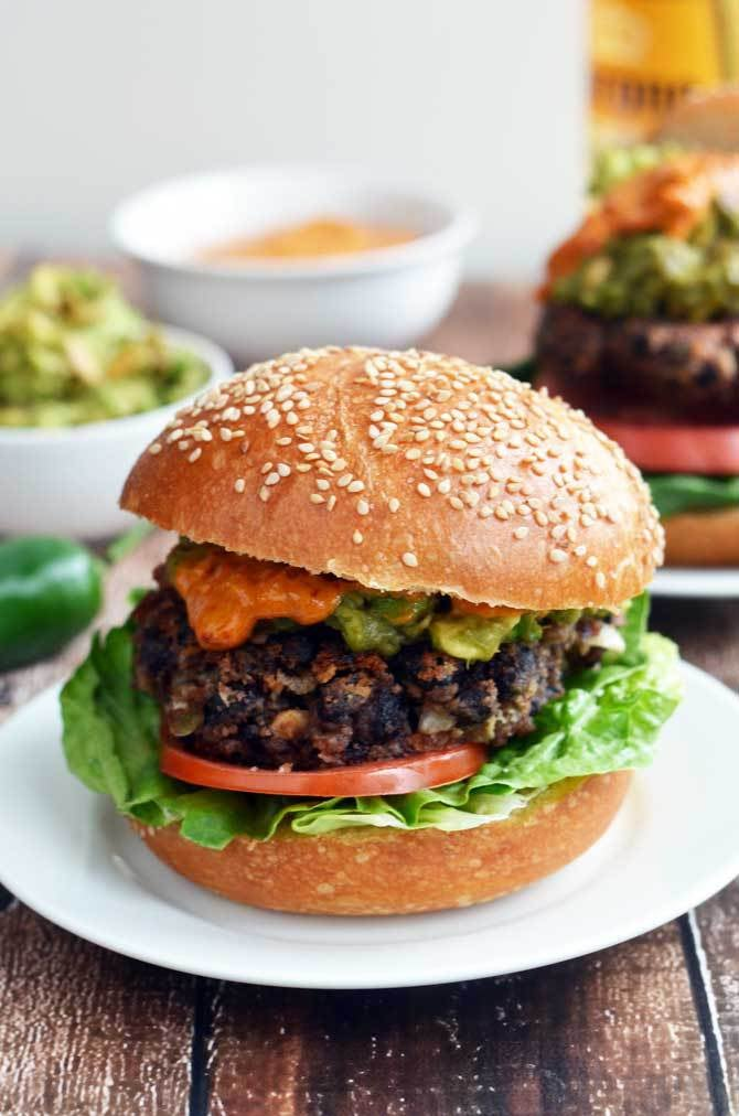 Black Bean Burgers With Chipotle-Lime Tahini Sauce and Guacamole