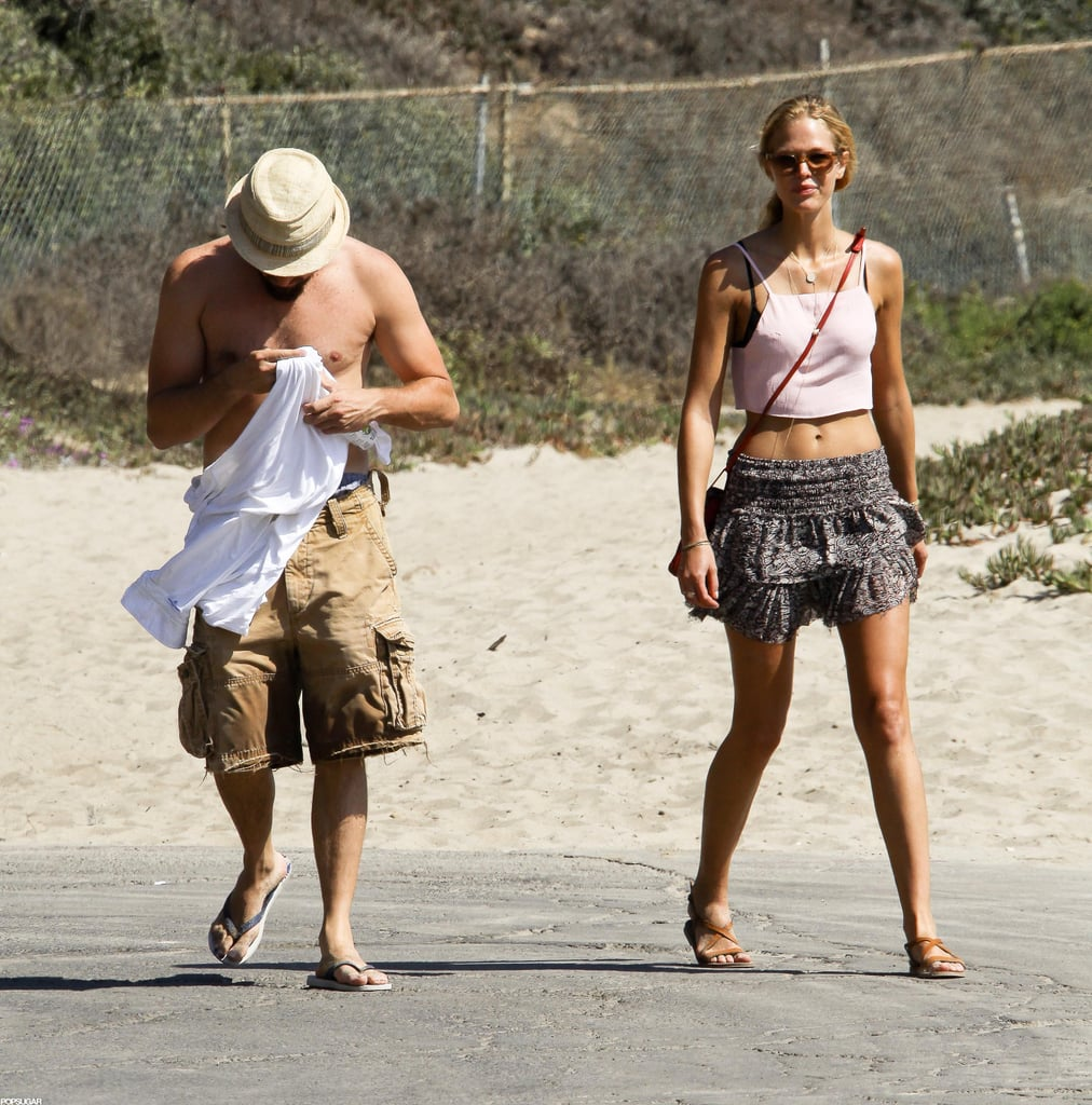 "Leonardo DiCaprio was shirtless yesterday to hit the beach in LA with his Victoria's Secret model girlfriend Erin Heatherton — don't forget to vote for Leo in our Summer shirtless contest! Even at the beach, Leo tried to go unrecognized by wearing his hat low over his face. Leo and Erin had time by the water after a vacation in Hawaii in July. He was able to fit in the time off after wrapping up work on Django Unchained. There's more work on Leo's plate, though, as his production company Appian Way just acquired the movie rights to a short story, ""Running Out of Dog,"" by Mystic River author Dennis Lehane."
