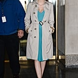 Here she offset a bright turquoise cocktail dress with a traditional khaki trench coat. If you're going for evening elegance with a twist, try her version — a classic silhouette with a bright pop of color.