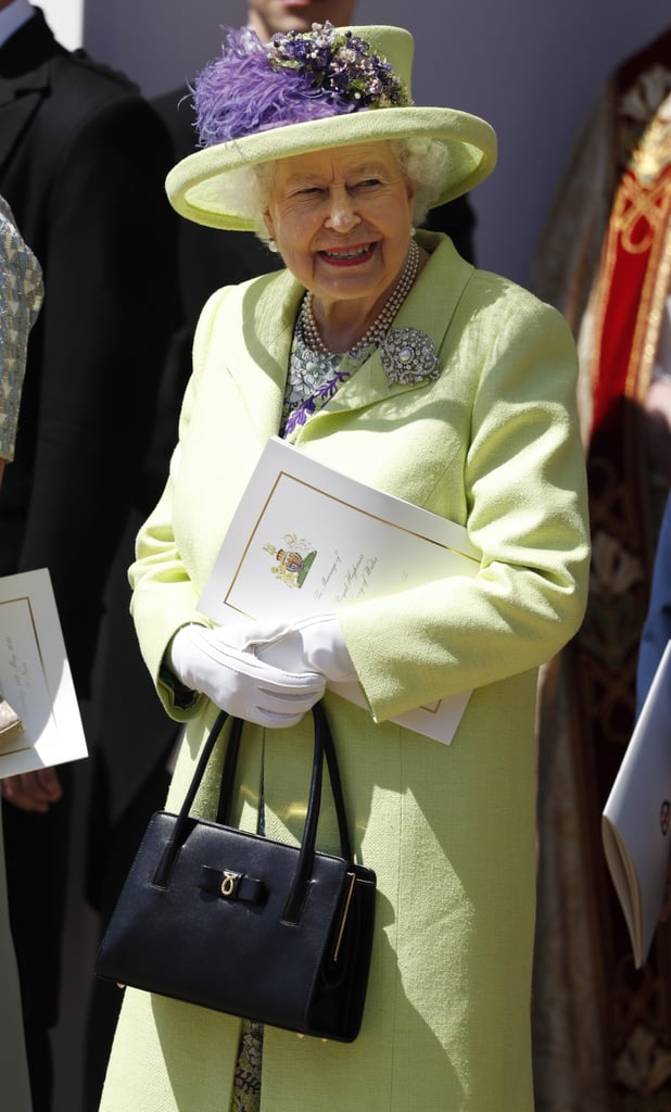 Leave it to Queen Elizabeth II to wear the most unexpected color to the royal wedding. It was easy to spot the royal as she made her way to the church for the wedding in a burgundy car. The British monarch chose a lime green flared Stewart Parvin dress. The bright ensemble featured a purple floral pattern, which she paired with a coordinating silk tweed coat. The queen accessorized her eye-catching wedding guest dress with a matching Angela Kelly hat that came in the same lime green hue. She finished off her look with a diamond brooch, Anello and Davide block-heel pumps, and a Launer handbag. Keep reading to have a closer look at her ensemble.         Related:                                                                                                           OMG —Meghan Markle's Wedding Tiara Is So Sparkly, She Looks Like a Disney Princess IRL