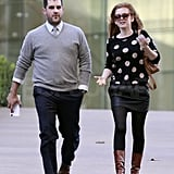 Isla Fisher left a meeting with a friend.
