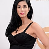 Inky black tresses, jet black dress — of course the only appropriate lipstick colour for Sarah Silverman was an electric pink hue.