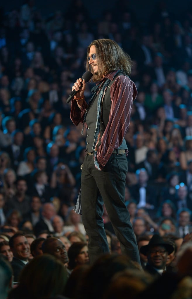 Johnny Depp took the stage to present the album of the year honor to Mumford & Sons.