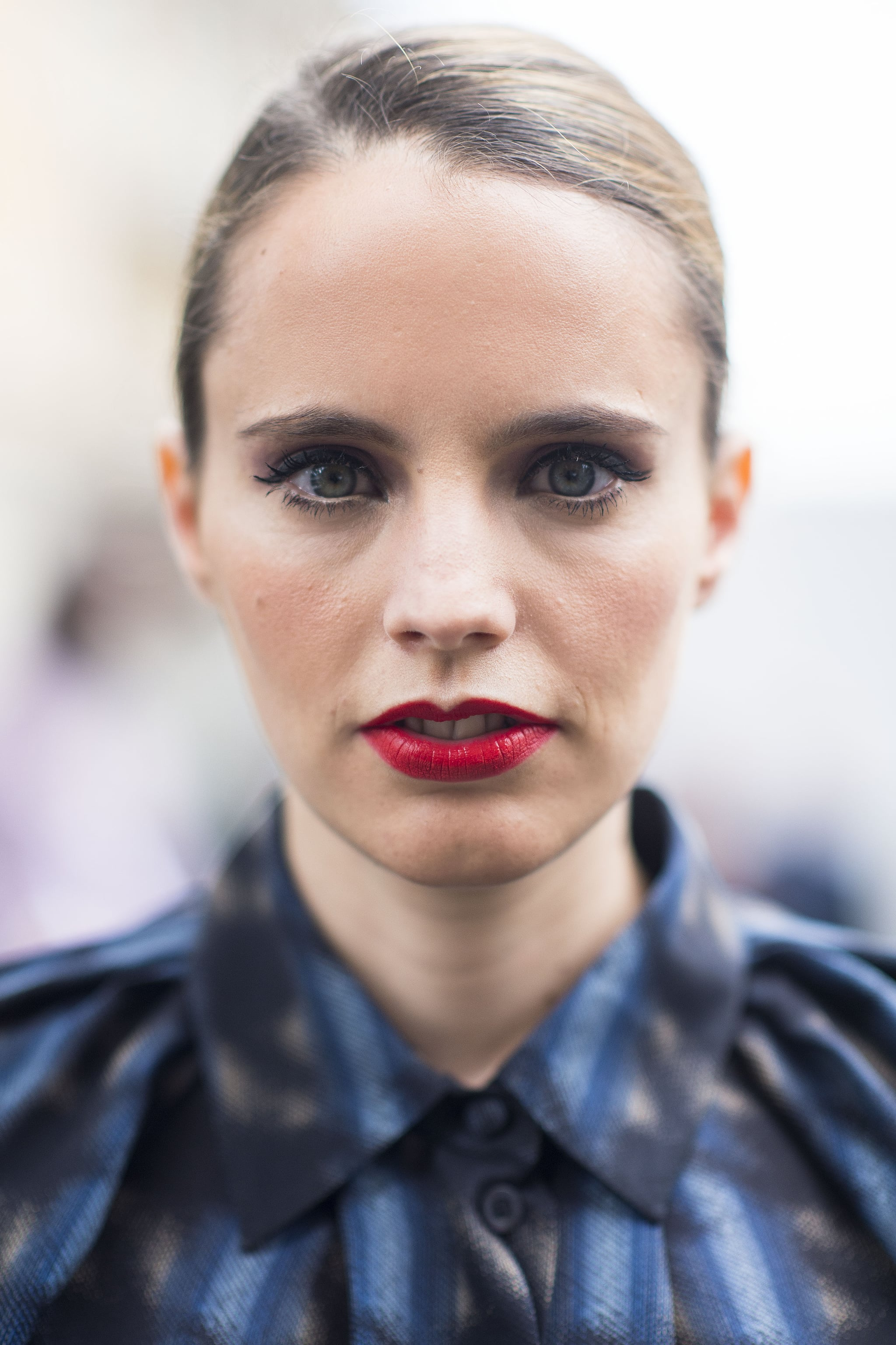 Graphic liner makes her red lip seem more modern than vintage. Source: Le 21ème | Adam Katz Sinding