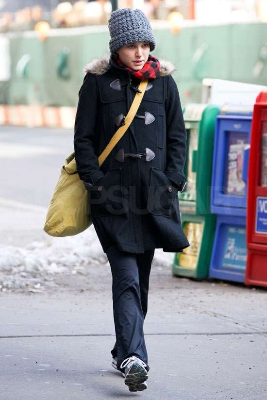 Natalie Portman wore a cute duffel coat and hat as she took a stroll solo in New York City yesterday. The expectant mum, who is apparently carrying a son, has been spending time with fiancé Benjamin Millepied in NYC after attending the Oscars nominees luncheon in LA earlier this month. She's staying US-based, and didn't make the trip across the pond to promote No Strings Attached with costar Ashton Kutcher in Paris and London. The actress also skipped the BAFTAs, so her Black Swan director, Darren Aronofsky, picked up her best actress award.