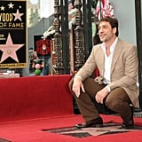 Javier Bardem knelt down next to his brand new star.