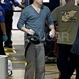 Channing Tatum let his suspenders down for security at the Los Angeles airport.