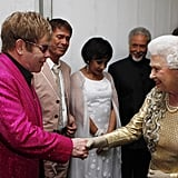 The queen shook hands with Elton John at the Diamond Jubilee Concert at Buckingham Palace.
