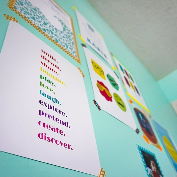 Hang a full gallery wall with colorful washi tape.