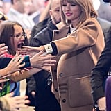 Taylor Swift greeted fans in NYC on Monday.