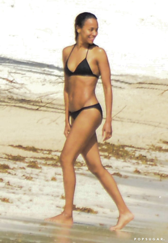 Zoe Saldana looked as happy as can be while taking a stroll on the beach in Mexico back in December 2015.