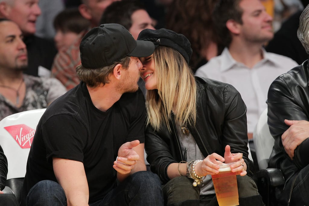 Drew Barrymore was in the front row at the Staples Center in LA on Friday night with her man Will Kopelman. The duo kissed and showed PDA throughout the game, during which the city's two teams, the Clippers and the Lakers, battled it out on the court. It was the latest romantic evening for the couple, who have been all about loved up lunches and traveling together since going public with their romance a month ago.