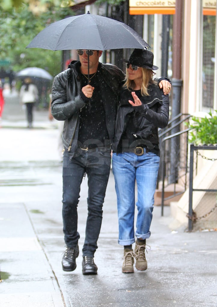 """Justin Theroux helped shield Jennifer Aniston from the rain as they left their NYC place today. The couple were out on their latest errand-running adventure since touching down in the Big Apple last week. They spent their weekend together, dining out, taking walks, and enjoying the beginning of Fall in the city. Work, though, will soon be keeping Jennifer busy. She's set to do press for her upcoming Lifetime project Five ahead of its debut on the network on Monday, Oct. 10. Jen's clearly focused on her filmmaking and her man Justin, while her ex-husband, Brad Pitt, is trying to clear up some statements he recently made about their marriage. After kicking up controversy by calling the '90s, when he and Jen were married, dull, Brad further clarified his Aniston comments. He said at yesterday's Oakland premiere of Moneyball, """"That was never my intention for it to be spun that way. People read things into it that just weren't there."""""""