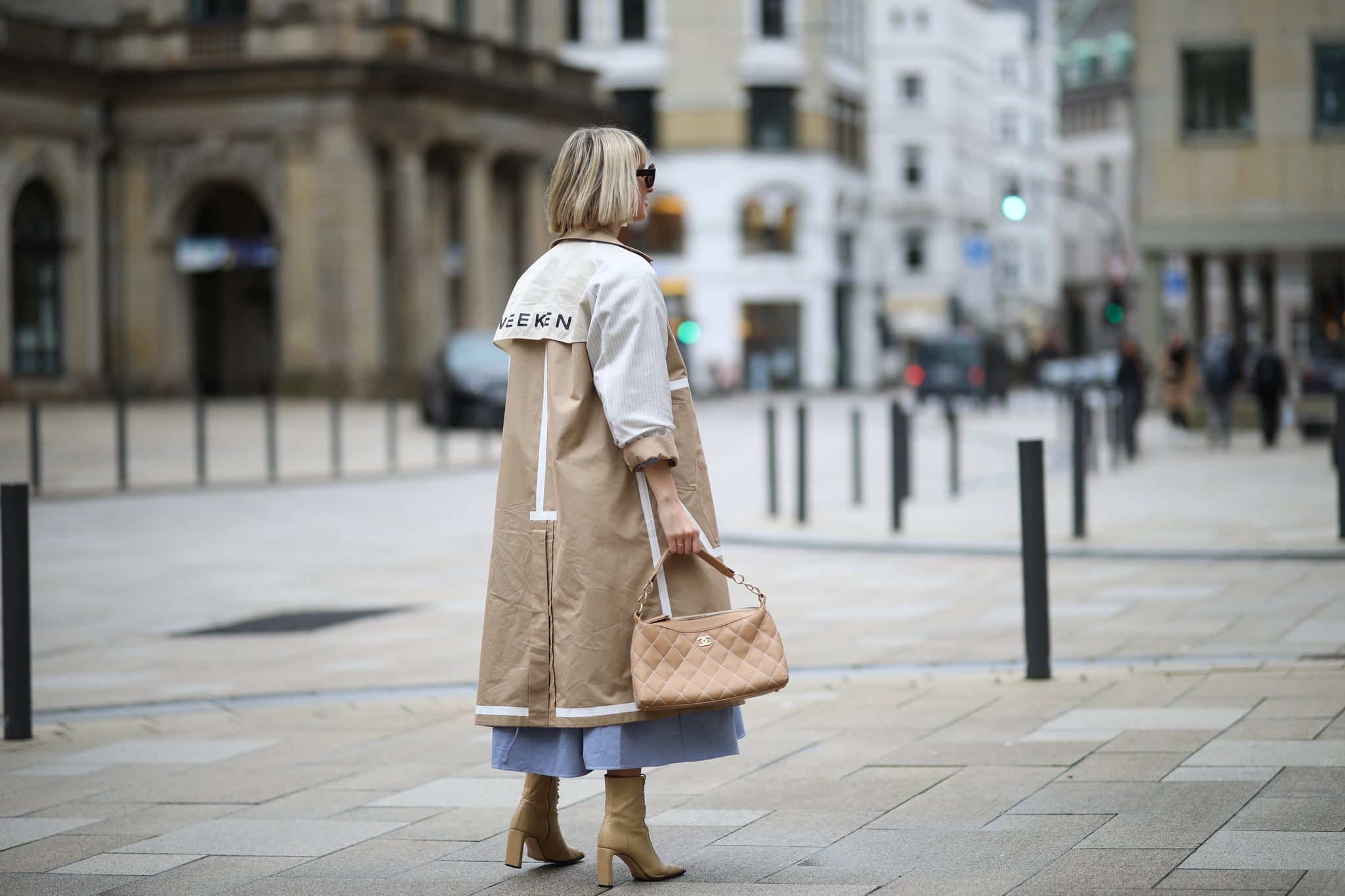 HAMBURG, GERMANY - FEBRUARY 01: Louisa Theresa Grass wearing Ghospell dress, Chanel bag, Max Mara coat and Zara boots on February 01, 2020 in Hamburg, Germany. (Photo by Jeremy Moeller/Getty Images)
