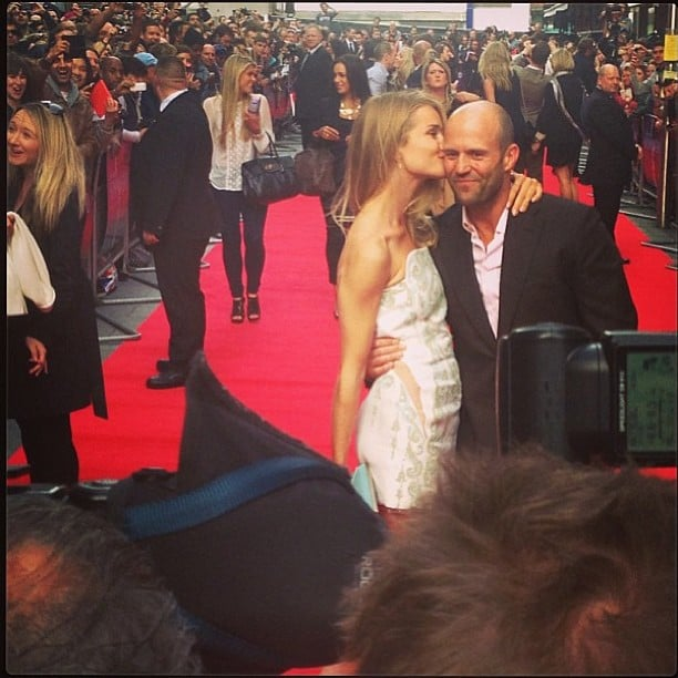 Rosie Huntington-Whiteley planted a kiss on her boyfriend, Jason Statham, at the premiere of his film Hummingbird in London. Source: Instagram user rosiehw