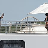 Here he is playing Instagram husband on a yacht in Tahiti with Michelle.
