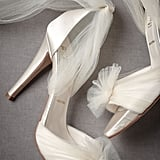 The gauze-wrapped, bow-tie details add an overtly girlie element. For that reason alone, we think this pair would look great with a shorter-hemmed dress. That way, you can really showcase the subtle surprises on the pump. BHLDN Auroral Vapor Heels ($350)