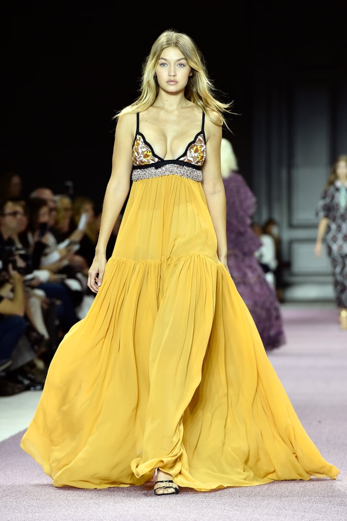 Gigi's Giambattista Valli look clearly stole the spotlight at the show; and maybe that's why she walked the runway last. The floaty, sheer gown swept the floor, and the upper bodice boasted glittering beaded detail that played up Gigi's glow. She wore buckled patent leather heels.