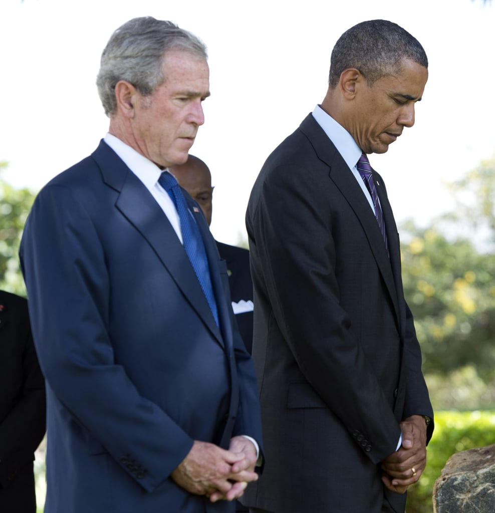 At the July 2013 wreath-laying ceremony for victims of the 1998 US Embassy bombing in Tanzania, President Obama and former President Bush bowed their heads in respect.