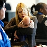 Claire Danes held baby Cyrus as she traveled through LAX.