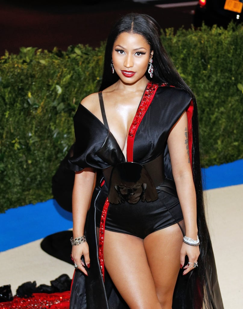 "Nicki Minaj knows how to make a statement on any red carpet, and her appearance at the 2017 Met Gala was no different. When Nicki arrived, photographers snapped and heads turned to see the rapper in a custom H&M ensemble, which honored Rei Kawakubo and the Comme des Garcons theme in such an incredibly distinct way. Aside from the obvious red and black color scheme that recognized Kawakubo's influence on the fashion world, we looked closer and saw Kawakubo's face featured on her leather obi belt.  Pernilla Wohlfahrt, H&M's head of design and creative director, said in a press release, ""Each H&M look has been entirely custom-made, with both Kawakubo's creative world and the style of our guests in mind,"" and Nicki's ensemble did that perfectly — staying true to her personal style while flashing as much skin as possible.  Her sheer custom gown was held by an off-the-shoulder duchesse satin kimono top designed with red Swarovski crystals. The lengthy train featured ""extravagant raw-edged silk taffeta and black vinyl roses trapped at the hem and beneath the train."" But the most exceptional detail of Nicki's entire custom look was the belt. Keep reading to see photos of Nicki's captivating ensemble.      Related:                                                                                                           Once Again, Fashion's Prom Night Has Begun — See Every 2017 Met Gala Look Here"