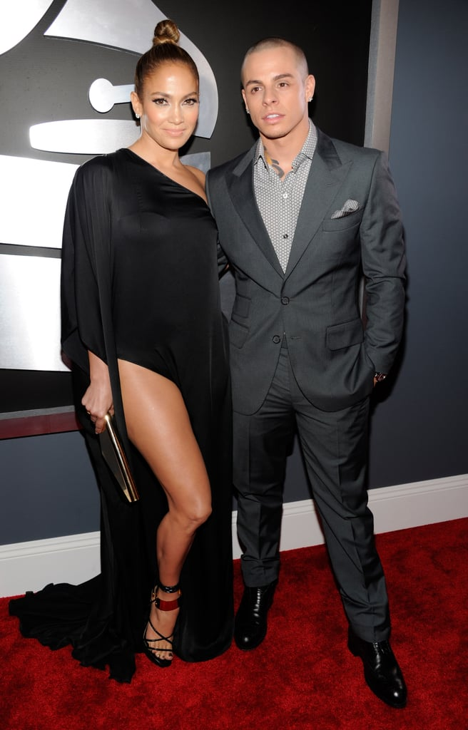 Jennifer Lopez posed with Casper Smart on the Grammys red carpet.