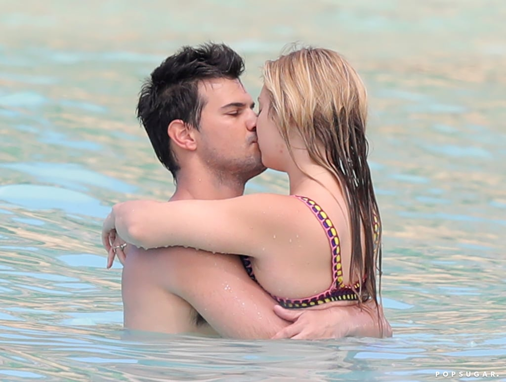 """Vacation? More like bae-cation. Billie Lourd and Taylor Lautner jetted off to St. Barts for some sunny R&R this week, which included a PDA-heavy beach day worthy of The Notebook. The Scream Queens costars, who have been dating since December, shared a few kisses while they splashed around in the ocean on Thursday. The couple was joined on their trip by Billie's father, Bryan Lourd, and stepfather, Bruce Bozzi, who shared a fun photo earlier this week on Instagram of the group trying out green face masks. Not a bad way to spend the day, right?  Since the heartbreaking passing of Billie's mother and grandmother, Carrie Fisher and Debbie Reynolds, Taylor has been a source of constant support for the 24-year-old American Horror Story actress. In January they escaped the cold weather with a fun-filled trip to Cabo and recently enjoyed an adorable date at the Antelope Valley California Poppy Reserve after opting out of attending her mother's public memorial.      Related:                                                                                                           Todd Fisher Calls Niece Billie Lourd a """"Pretty Powerful Gal"""" Following Her Mother's Death"""