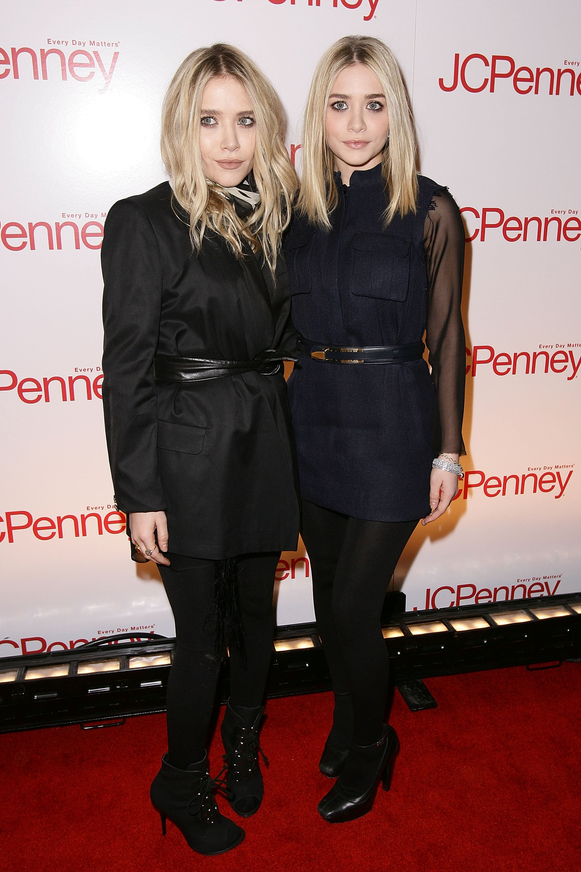 Twinning combo: The blond duo posed in cinched dresses and black tights for the JCPenney's Best of Spring Showcase in March 2010.  Mary-Kate stuck with an all-black palette in a cinched Dries Van Noten blazer and suede booties. Ashley married navy and black in a sleeveless wool-blend minidress by Jil Sander with black tights and Mary Janes.