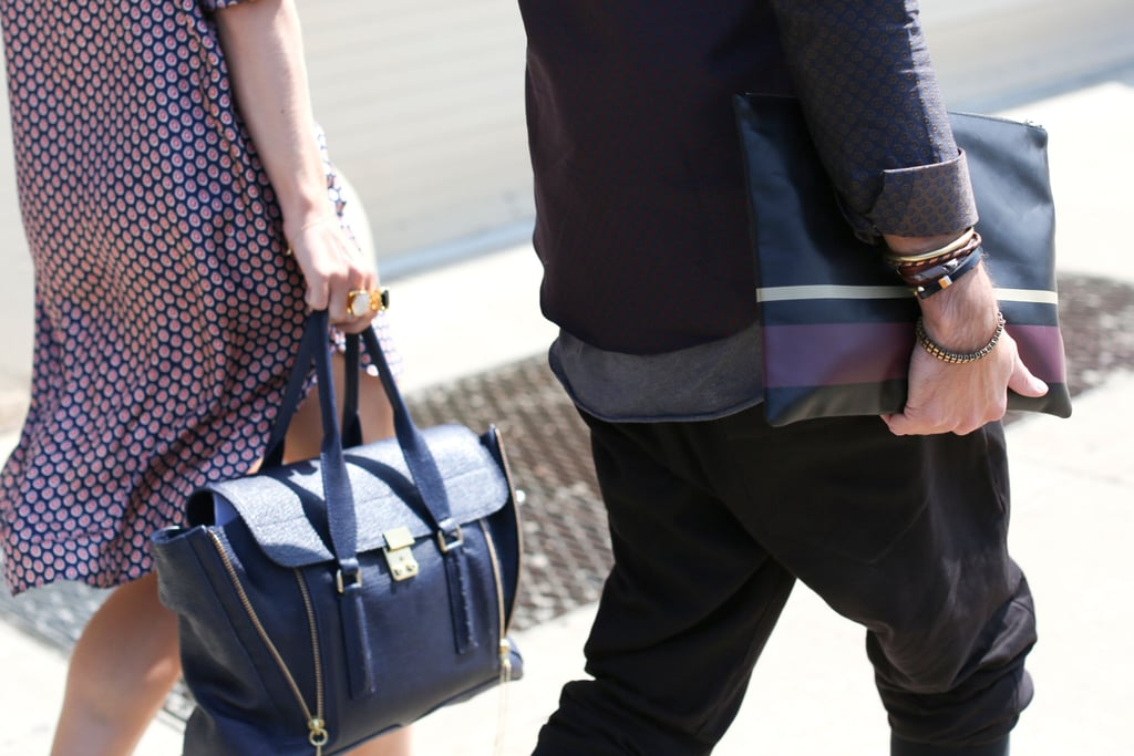 A navy Pashli made its way to a show (in the clutches of a print-clad showgoer, at left). At right, we got another rendition on the oversize clutch, this one with moody Fall colorblocking.