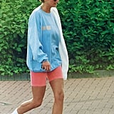 Princess Diana also wore the same peach cycling shorts with a blue sweatshirt and white sneakers.