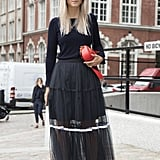 With a Long-Sleeved Black T-Shirt and a Tulle Maxi Skirt