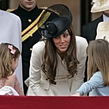 Kate looked very maternal while talking to two young royals, Estella and Eloise Taylor, at the queen's official birthday parade in London on June 2011. We wonder what she was saying to the little girls!