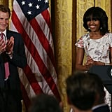 Prince Harry clapped as he stood next to Michelle Obama at a charity event in DC.